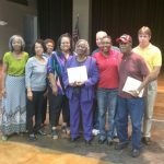 """Ms. Siplin stated that it was difficult to narrow the top volunteer honor to one person. Mrs. Elouise Kelly And Mrs. Kelly and Mr. William """"Bill"""" Harleaux were honored as top volunteers. Mrs. Kelly's family at left surprised her."""